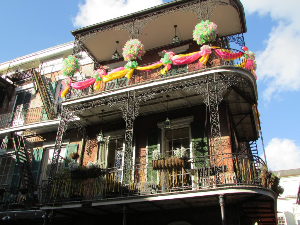 New Orleans wrought iron balconies and Mardi Gras paraphernalia - Photo courtesy of Elina Djebbari