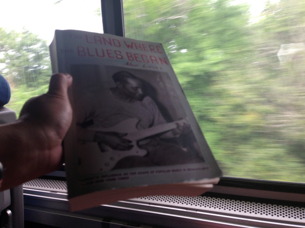 Reading Alan Lomax while crossing the Mississippi River. Photo courtesy of Ananya Kabir