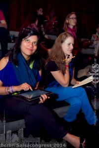 Ananya Kabir and Joanna Menet with traditional and new research tools at the Berlin Salsa Congress. photo courtesy Daniel Kyun.